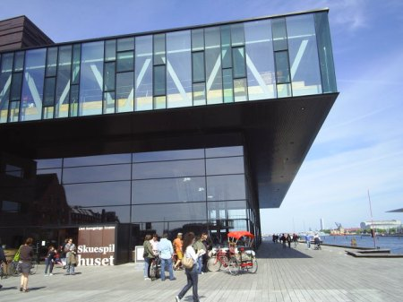 The new National Royal Theatre. Build 2004-07. Start of the route along the Copenhagen Harbour waterline. View in direction Copenhagen Inner Harbour to Royal Opera and Holmen to Øresund